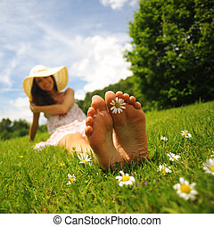 sunny day and Leisure - a smiling young woman is lying on a...