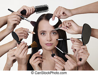 many hands make light work - woman doing make up with many...