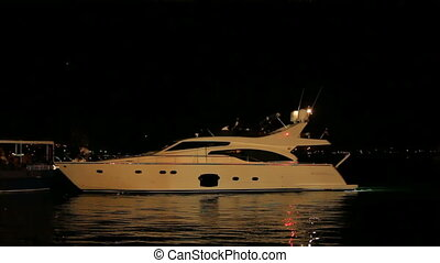 A yacht at night