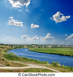 river and deep blue sky with clouds