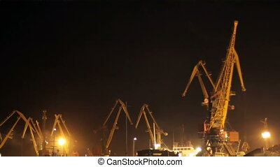 Cargo cranes at night