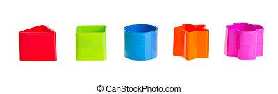 Shape Sorter. Stacks of Toy Blocks on background - Shape...