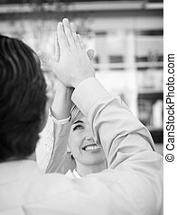 Business high-five - Businessman and Business woman wearing...
