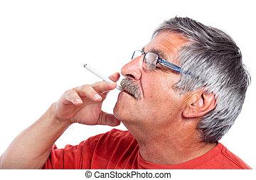 Senior man smoking cigarette - Elderly man smoking...