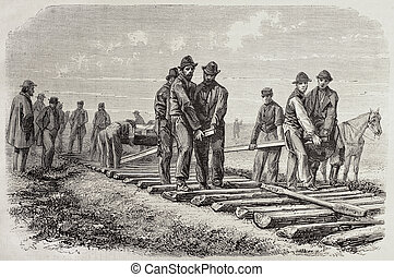 Setting rails - Antique illustration of workers setting...