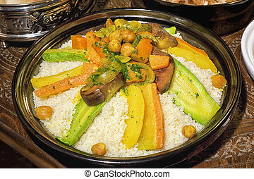 Moroccan couscous - Moroccan couscous tagine on carved,...
