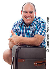 Happy traveller man with luggage - Happy smiling traveller...