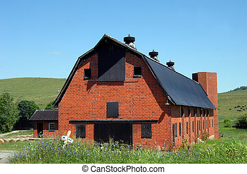 Old Red Brick Barn - Big, red brick barn has tin roof and...