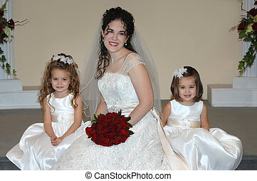 Awaiting the ceremony - Bride and her two flower girls rest...