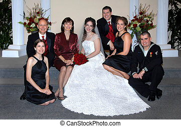 Support Group - Bride and family sit on the steps of church...