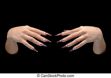 Closeup of hand of young woman long nail-art manicure on...