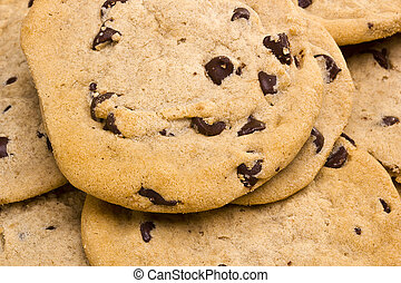 Chocolate Chip Cookies - Close-up photograph of a pile of...