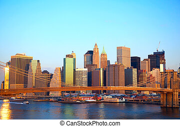 Manhattan at sunset - Brooklyn Bridge and Lower Manhattan...