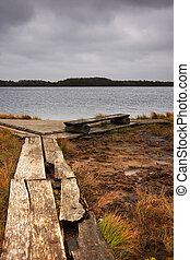 Timber road, bench and lake in mars - Wooden road lead to a...