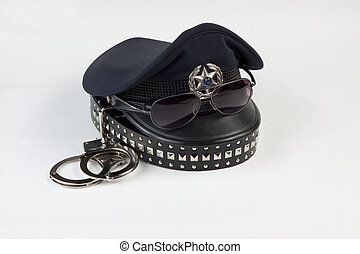 Police hat and a belt with handcuff - Police cap with...