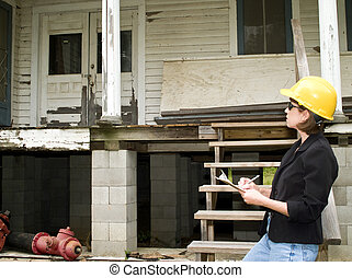 Estimating the Repairs - A woman standing in front of an old...