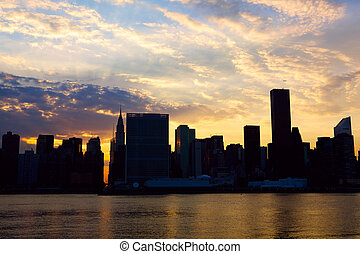 Manhattan at sunset - Sunset time view of New York City...