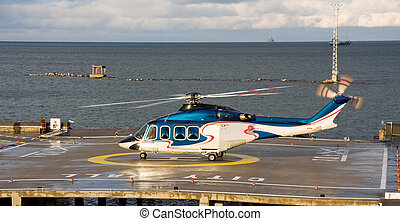Helicopter - A photo of passenger helicopter waiting to take...