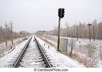 old semaphore on snow railway