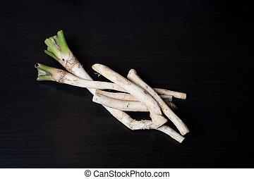 horseradish close-up on black background