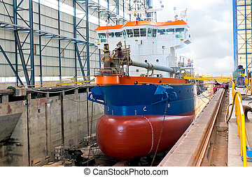 Ship in  shipyard's covered dry dock
