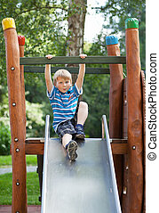 Boy at playground - Little blond boy on an outdoor...