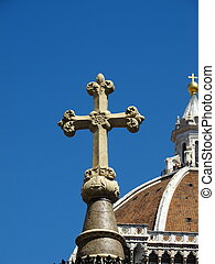 Christian cross with Basilica in background