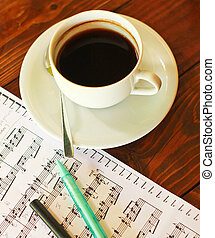 Hot coffee on music note with pen