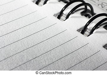 Side of notepad with wire binding - Lined pad paper with...