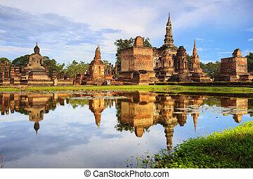 Main buddha Statue in Sukhothai historical park -...