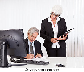 The boss signing a document