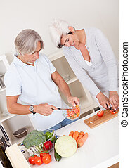Middle-aged couple preparing a meal