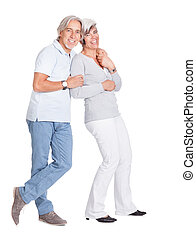 Happy loving senior couple standing in an intimate embrace...