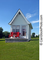 Cottage lodging - Cottage has bright red chairs to match its...