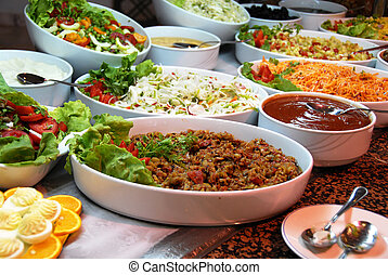 Various food in buffet - dishes with various salads in...