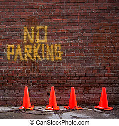 No Parking - Brick wall with no parking written on it....