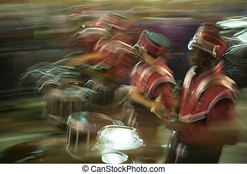 blurred image of marching high school band - New Orleans,...