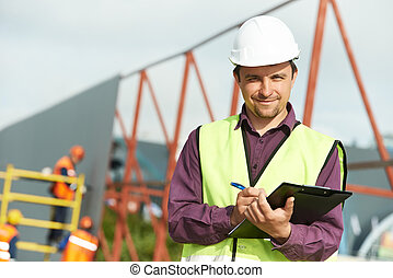builder site manager worker at construction site - site...