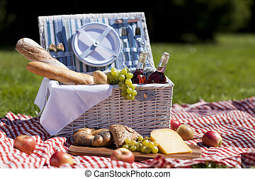 Picnic Time - Fresh food from picninc basket in the garden