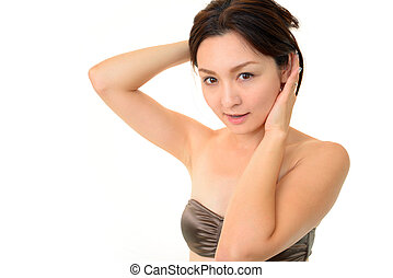 Young woman touching her hair - beautiful young woman...