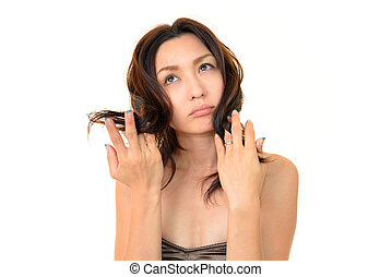 Distressed with hair fall - beautiful young woman touching...