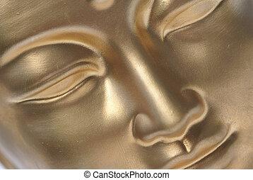 A golden face.