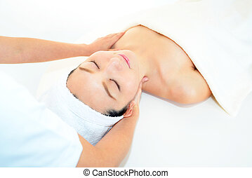 Woman receiving massage - Beautiful young woman receiving...