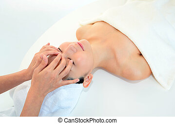 Woman receiving facial massage - Beautiful young woman...