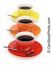 Cups of coffee standing in line. - Three cups of coffee...