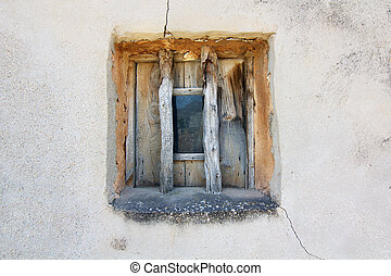 Old window on a cement wall