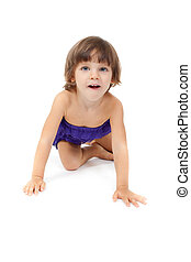 Little girl crawling on the floor