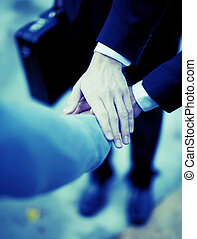 business hands - close-up of three businessmen hands on top...