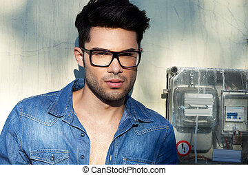 Young attractive fashion man wearing glasses , outdoor...