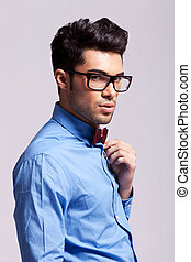 fashion man wearing bow tie and glasses - side view of a...